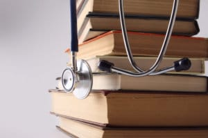 Books and Stethoscope - How Hard is the MCAT